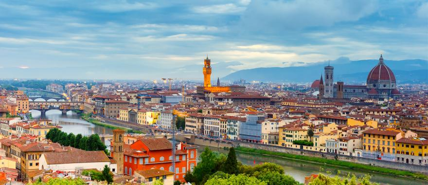 View of Florence with the Arno River in the foreground and the Cathedral of Santa Maria del Fiore in the background