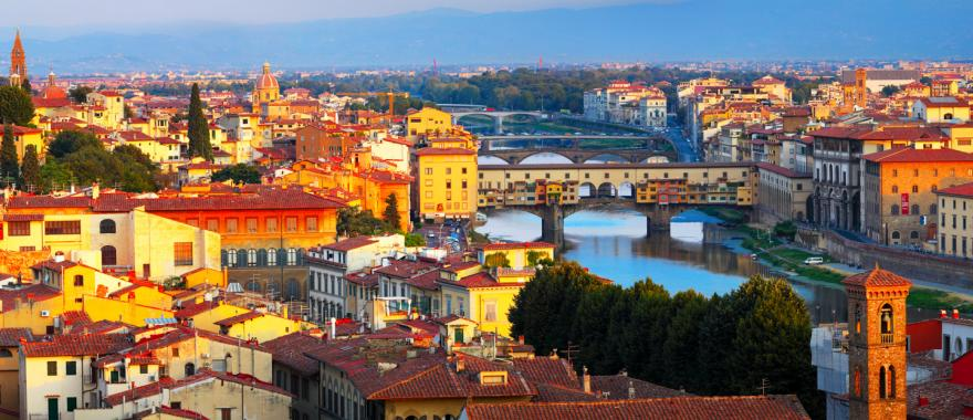 View of the Arno River running through Tuscany, Florence, Italy at sunset