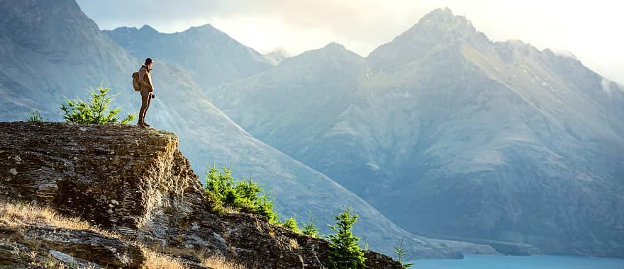 new zealand queenstown hiker looking over lake.