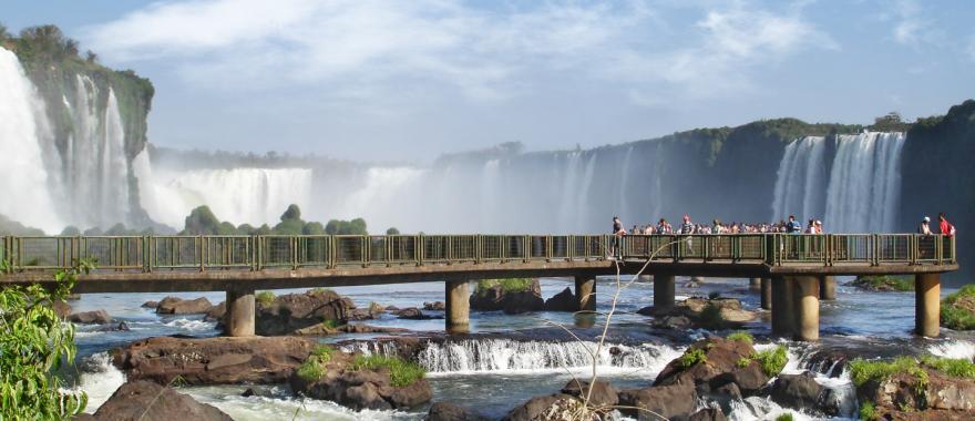 Visitors get a stunning view of Iguazu Falls from a viewing platform.