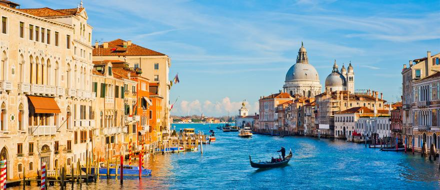 Boats and gondoliers on the Grand Canal in Venice, Italy