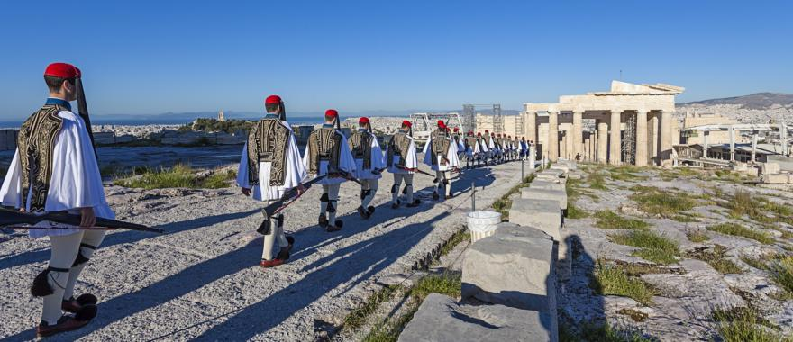 Presidential Guards march through the ruins of the Acropolis in Athens, Greece.
