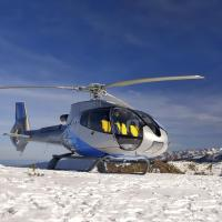 Heli-skiing in snow covered mountains.
