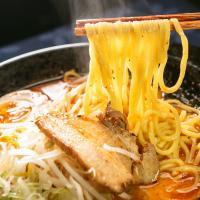 Japan Tour - Chopsticks Scooping Noodles from Bowl of Miso Ramen
