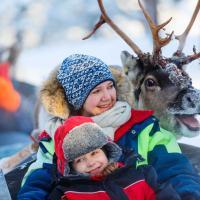 Family on reindeer safari.