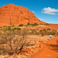 a person walks in kata tjuta national park alice springs