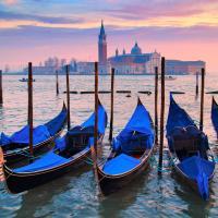 blue gondolas on water in venice
