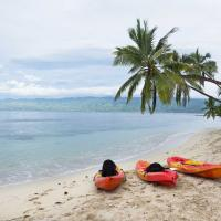 Kayaks on the beach in Fiji.
