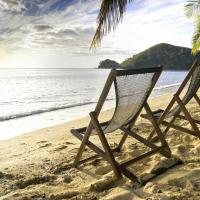 Wood beach chairs in Fiji.