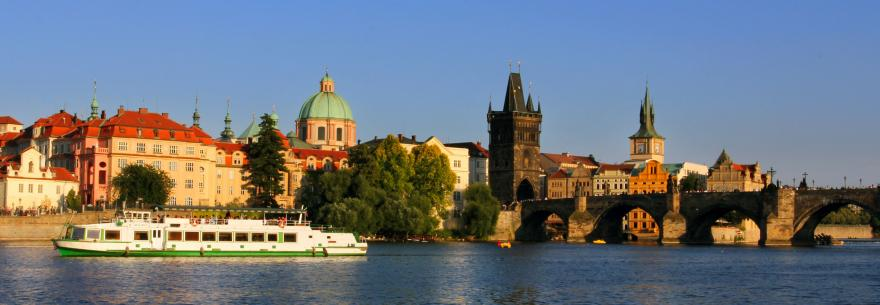 A boat cruises down the River Vlata in Prague.