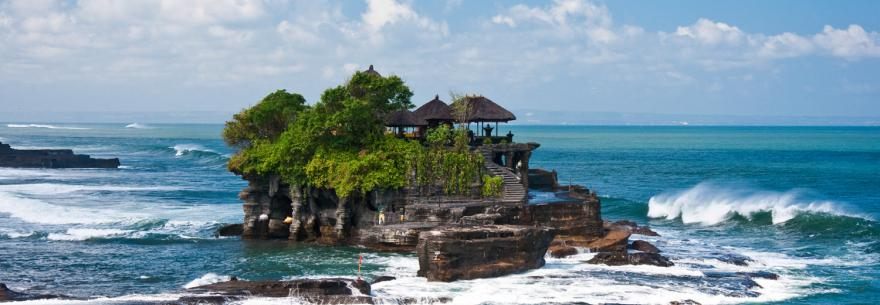 A temple located on a rocky island off the coast of Bali.